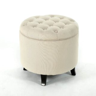 Accent storage ottoman with nail-heads and a unique round shape design.
