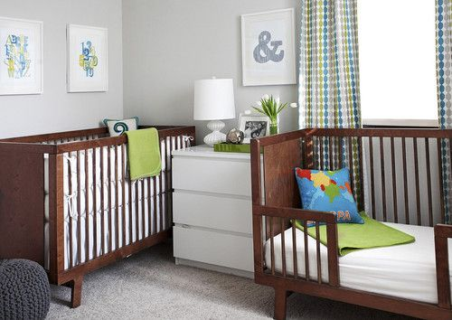 Modern wooden crib with stationary four sides and soft cushion bedding.
