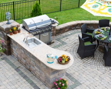 Nice outdoor kitchen on brick patio