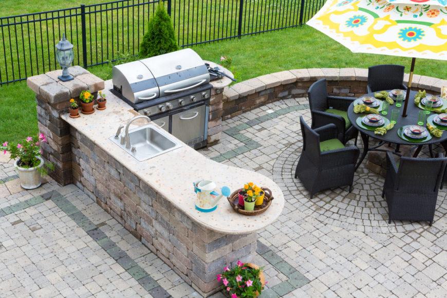 Nice outdoor kitchen on brick patio