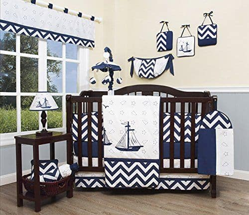 Nursery crib bedding set with nautical theme and cotton material.
