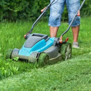 Picture of a small lawn mower cutting grass