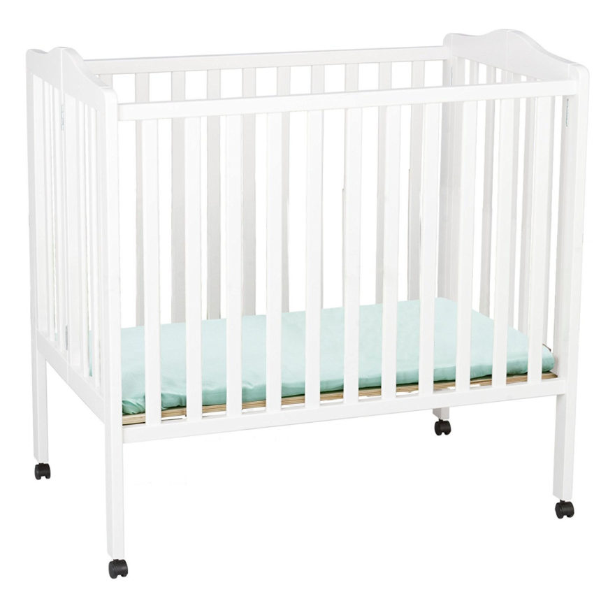 Portable mini crib with white finish and lightweight multi-purpose function.