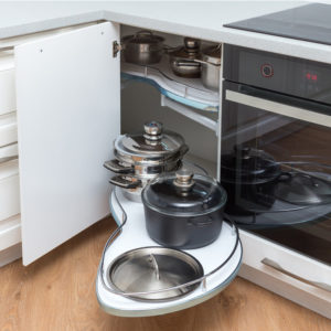 Small corner kitchen cabinet with pull-out pot storage