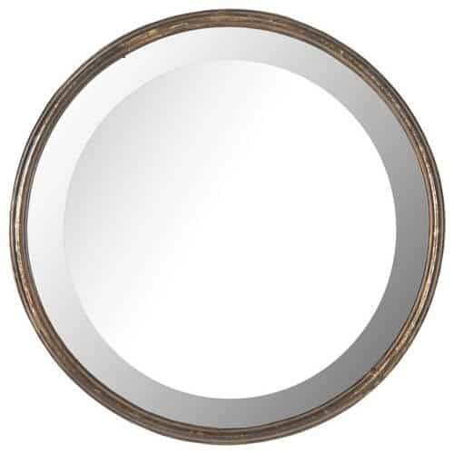 Round, beveled mirror in a gold frame looking all so regal and fancy.
