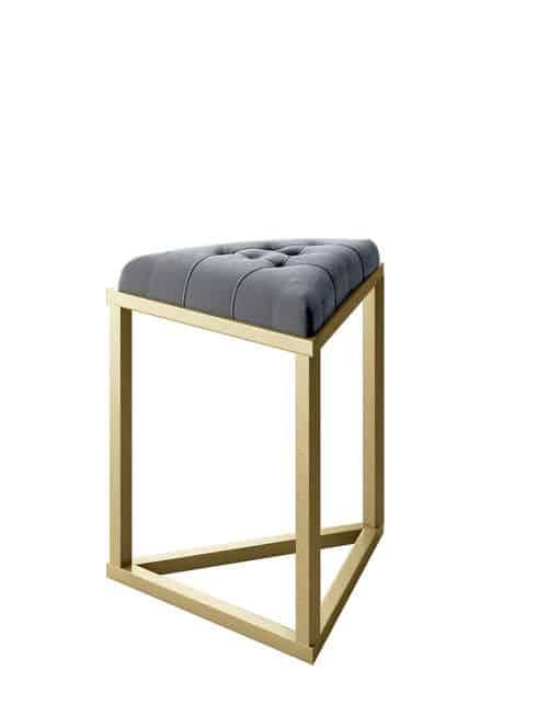Modern small stool with gold metal frame and gray velvet upholstery.
