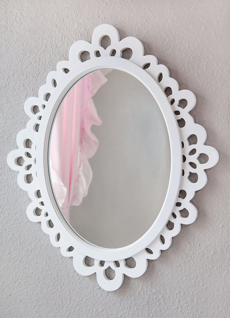 Oval mirror in a white wooden frame with lace designs.