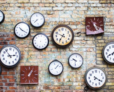 Brick wall with small wall clocks