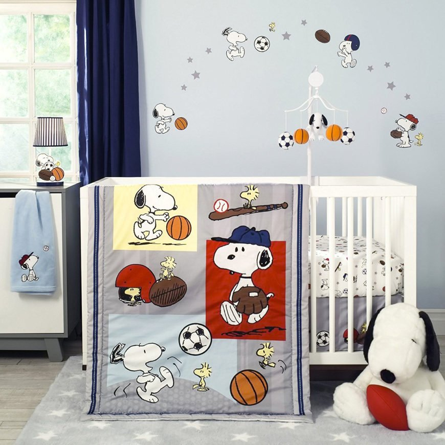 Snoopy sport crib bedding set with comforter and fitted sheet.