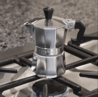 Stovetop aluminum espresso maker with metal body and gas compatible.