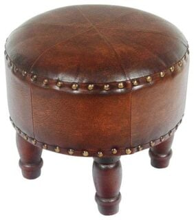 Small brown ottoman made with faux leather.
