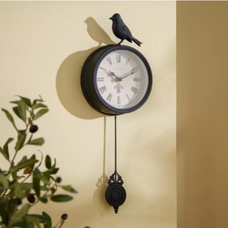 Vintage bird pendulum wall clock with rich black finish and swinging pendant.