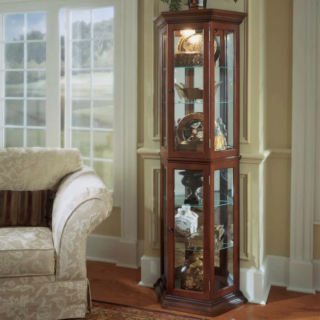 Hollingdon lighted corner curio cabinet with cobbler and birch veneer materials and walnut finish.