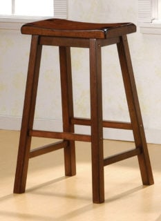 Walnut dining bar stool with curved saddle seat and foot support stretchers.