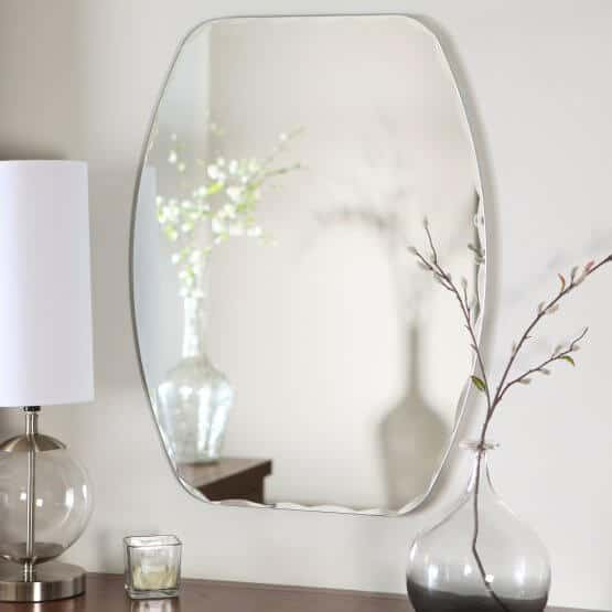 Frameless mirror in an aesthetical shape, perfect for bedrooms and bathrooms.