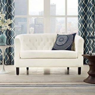 White, synthetic loveseat with a nice, velvet finish.