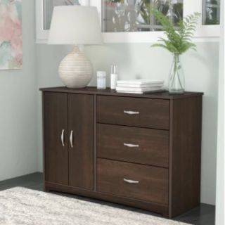 This wooden dresser is a combination of three vertical drawers and a two-door cabinet.