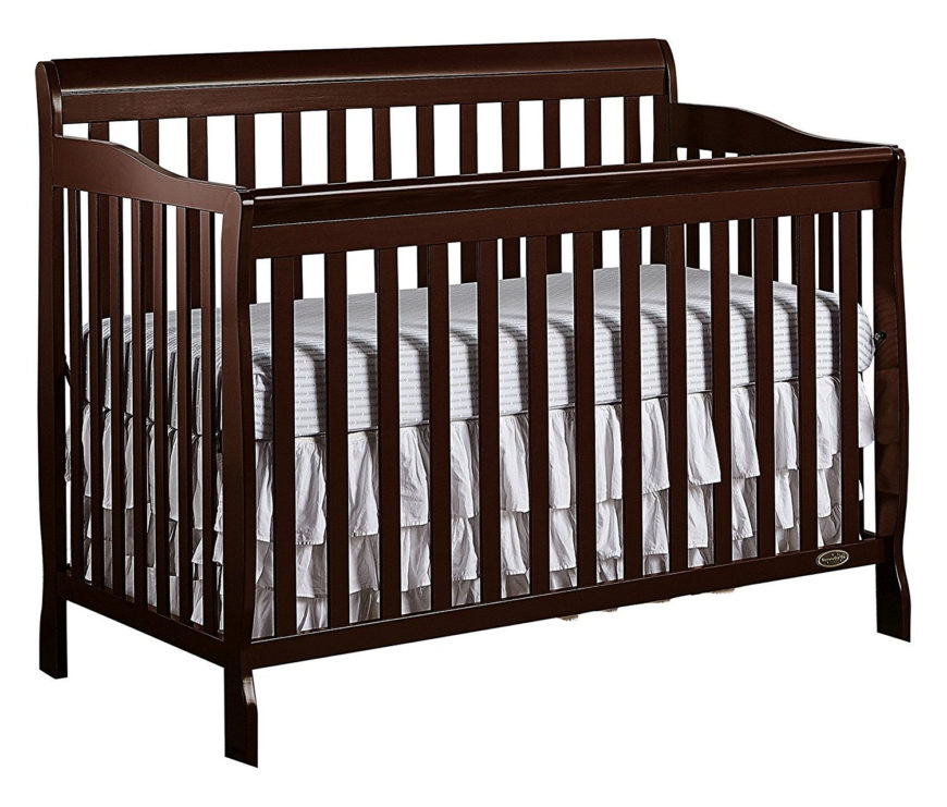 Wooden convertible crib with espresso finish and four position mattress support system.