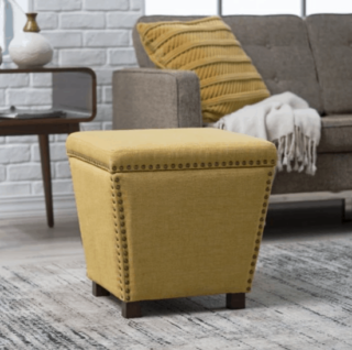 Yellow square ottoman with sturdy wood frame and nailhead trim design.