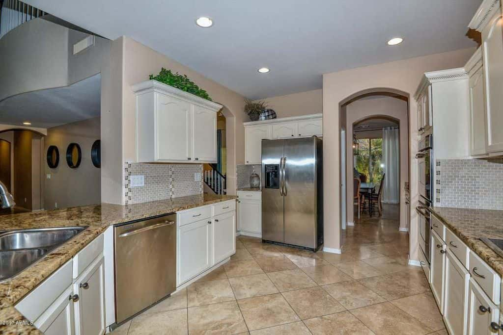 Superbe Contemporary Kitchen With White Cabinetry, Stainless Steel Appliances And  Arched Doorways.Source: Zillow Digs