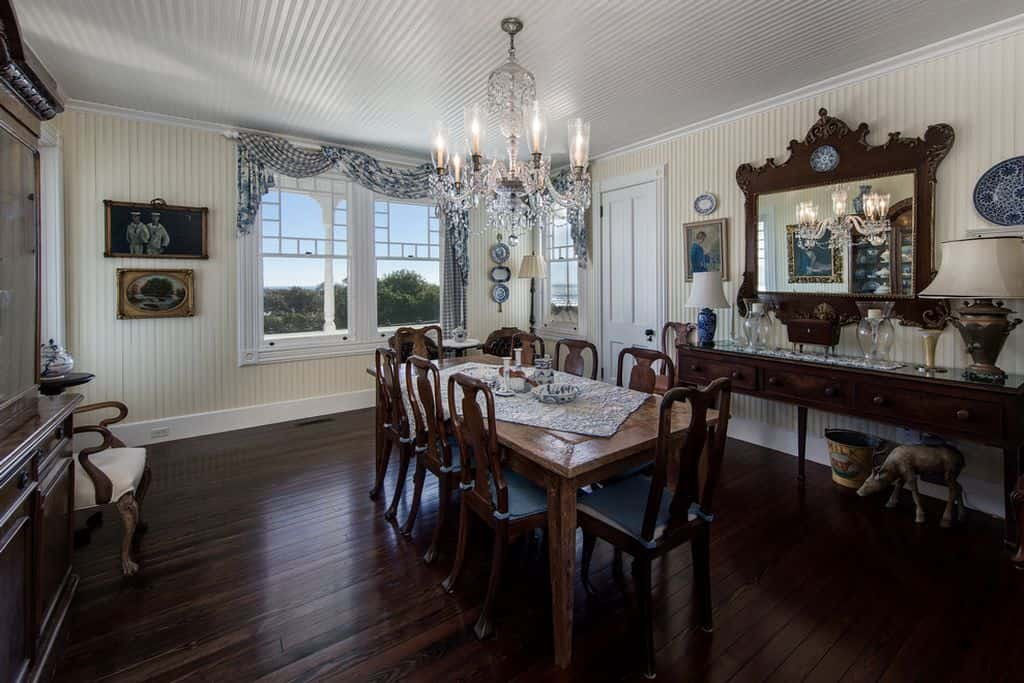 Country dining room with hardwood floor and chandelier.