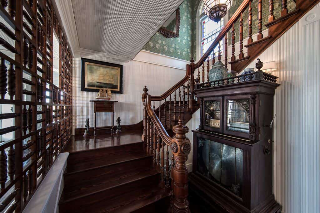 Farmhouse staircase with hardwood floor.