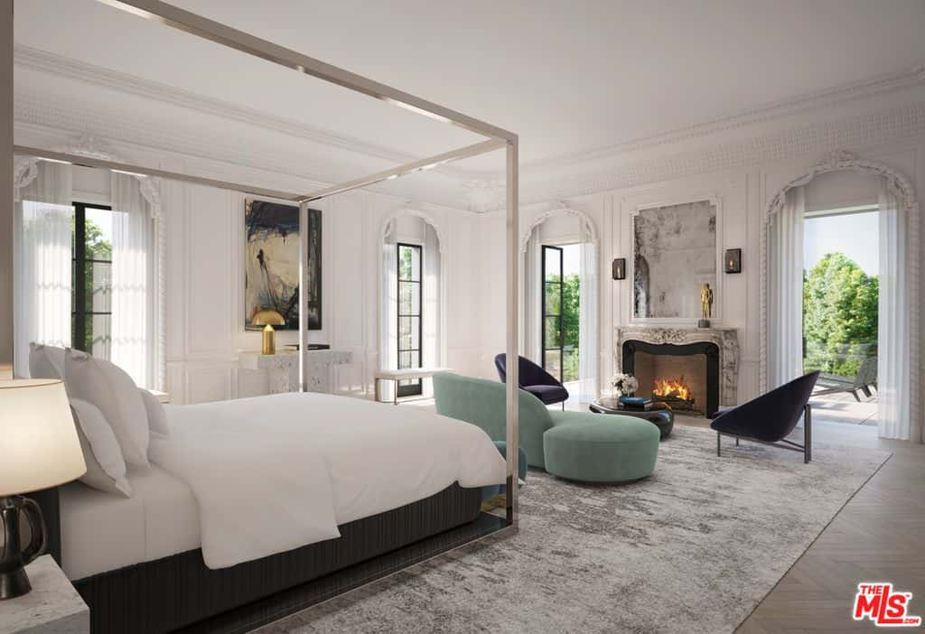 Mediterranean bedroom with fireplace and bed with white sheets.