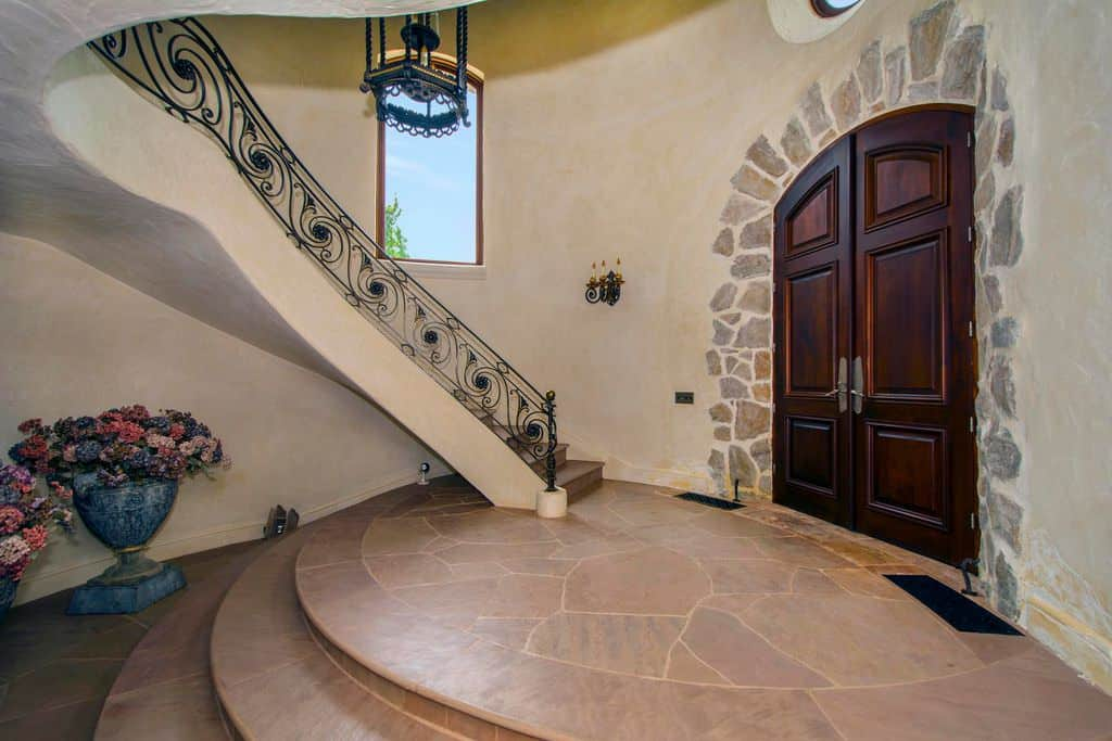 Rustic quarter-turn style staircase.