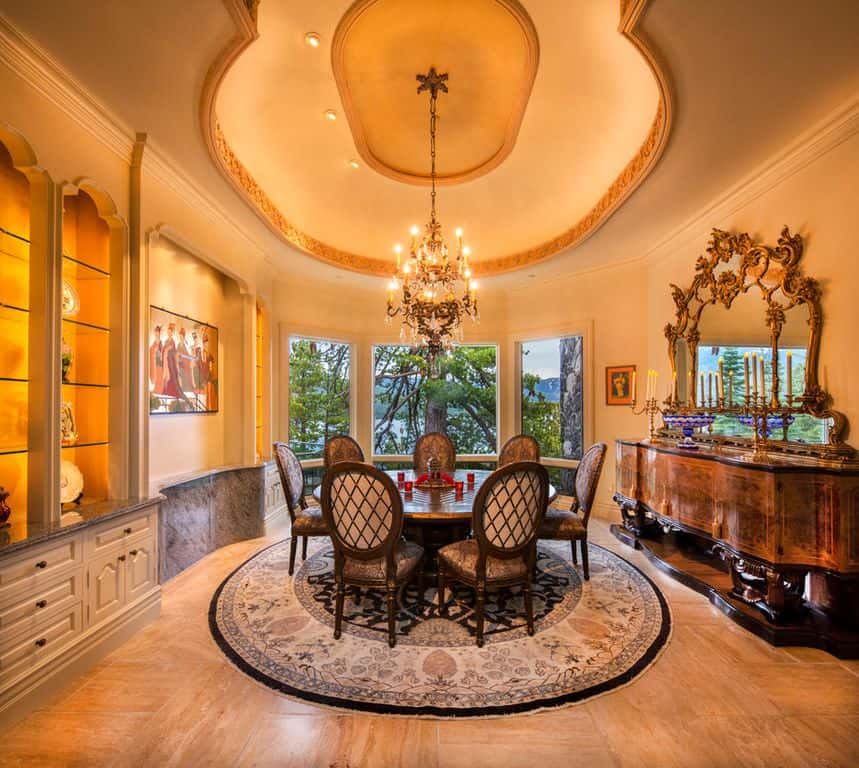 Traditional dining room with floor with rug and chandelier.
