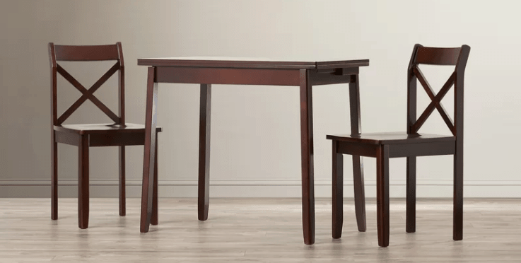 3 piece dining set with self-storing leaf in walnut finish.