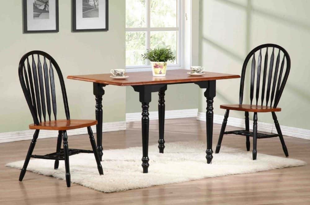 3 piece drop leaf dining set with arrowback chairs and malaysian oak construction.