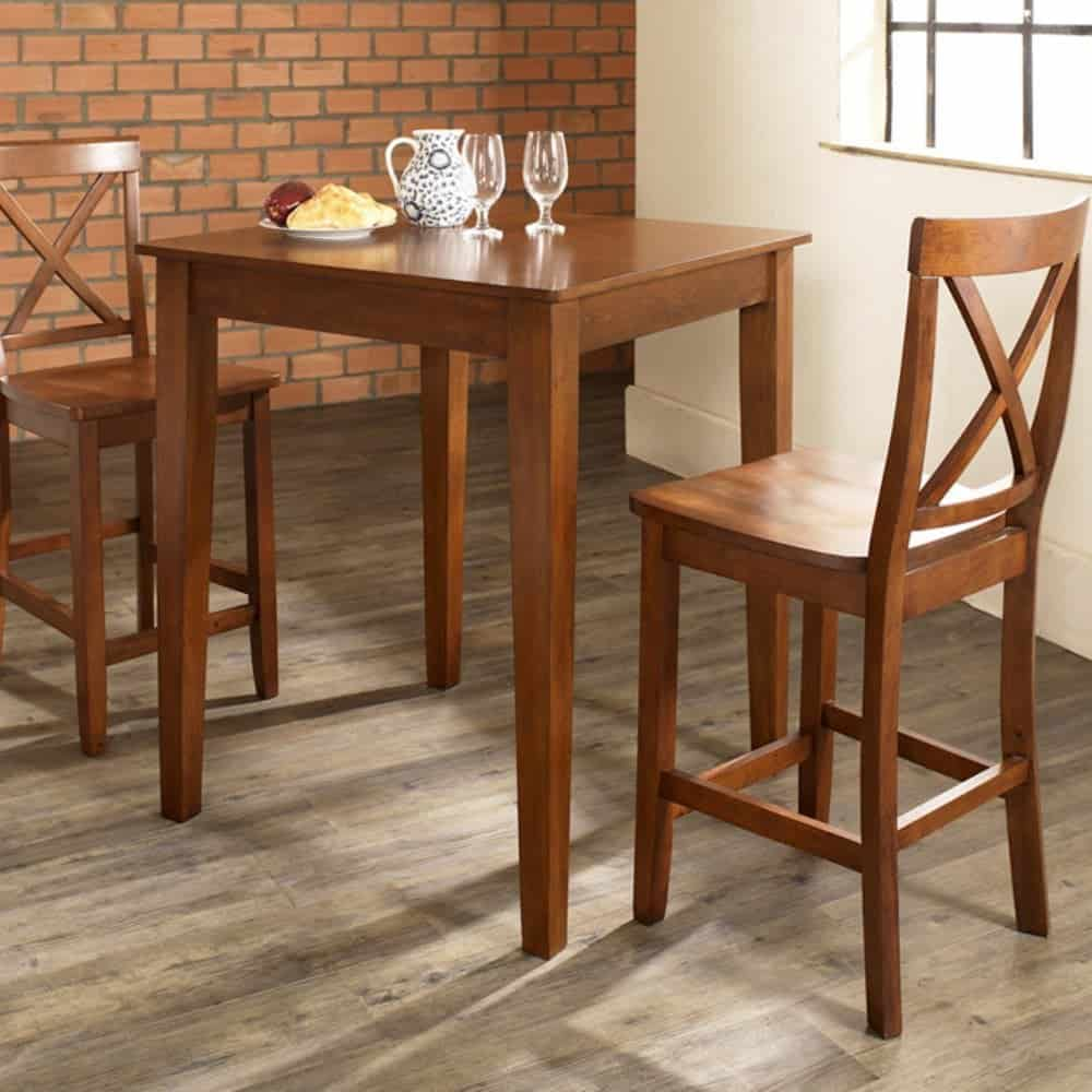 3 piece pub dining set with tapered legs and x-back stools.