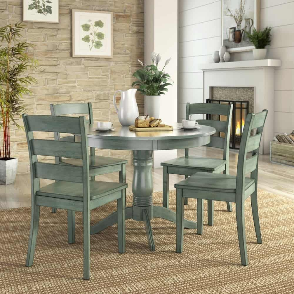 5 piece round dining table set with ladder back chairs and rubber hardwood.