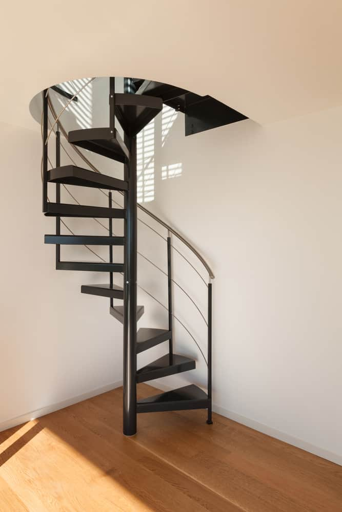 Black steel spiral staircase with cable railing