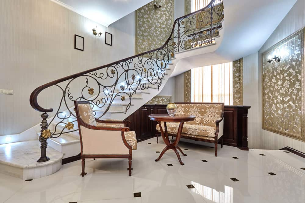 Marble staircase with ornate iron railing