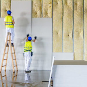 Men putting up drywall