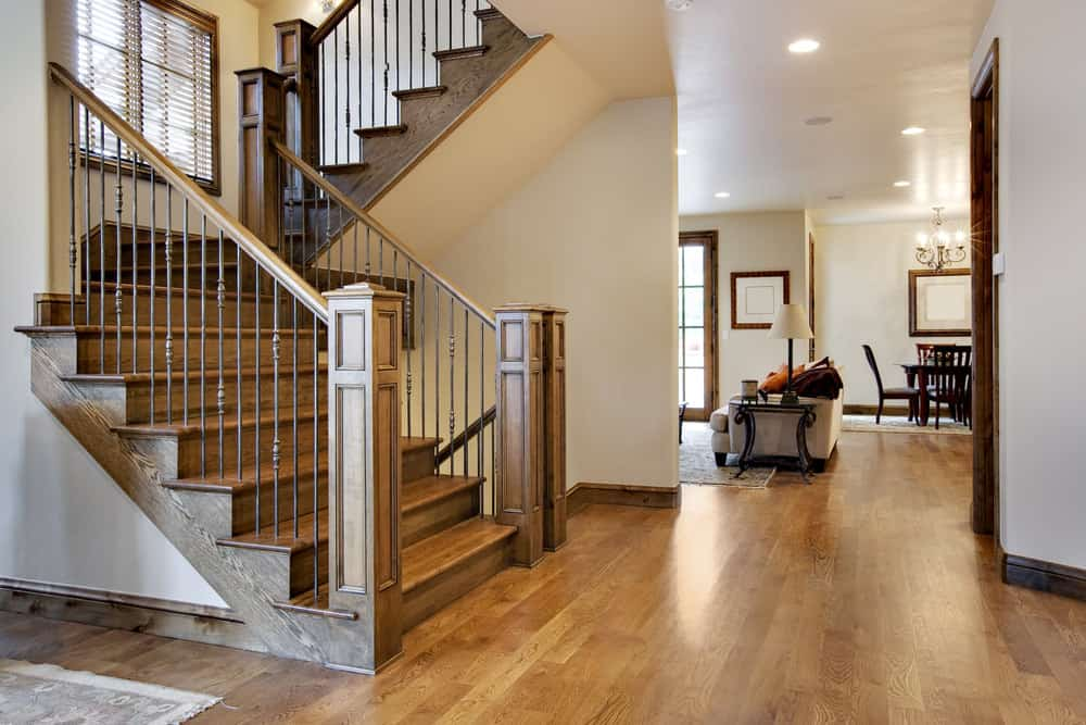 Natural wood staircase with wood riser, tread and railing.