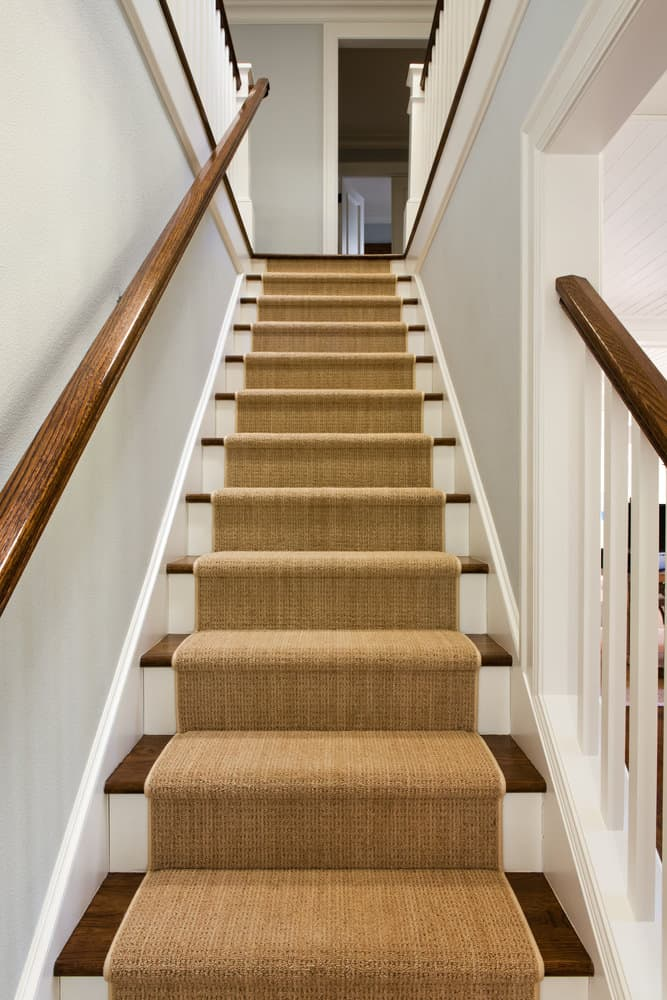 Straight staircase with brown runner