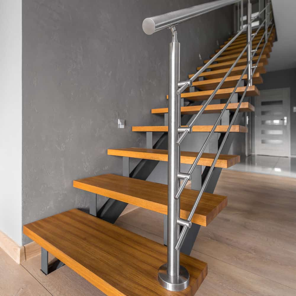 Wood and steel modern staircase. Wood tread with steel support beams and railing.