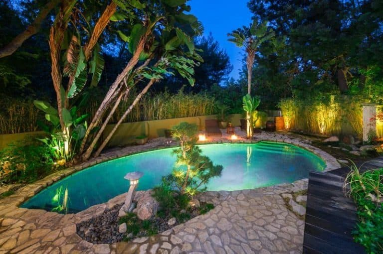 The lagoon-like pool is much more beautiful at night showing the beauty of the flagstone ground and the lighting.