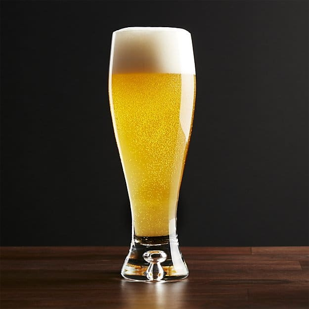 Beer glass with curvaceous contours and thick sham base.