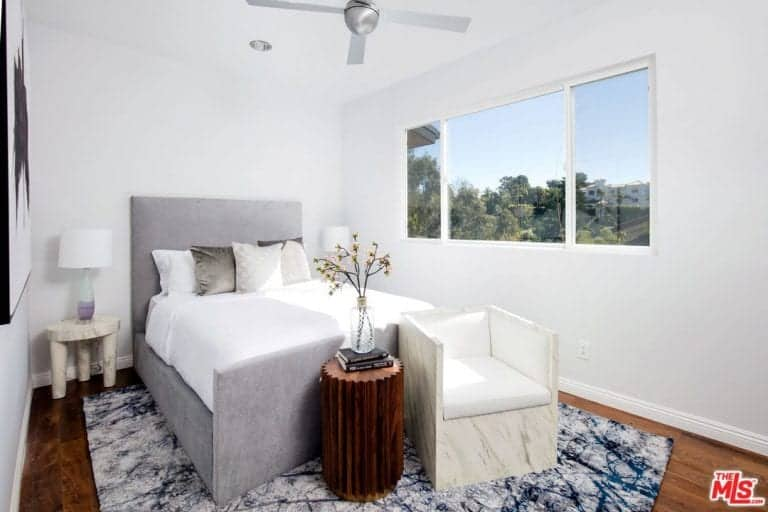 A guest room with a clear glass window overlooking the Malibu trees is also present in the house.
