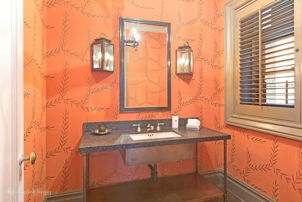 The house also features wash area surrounded by a stylish orange walls.