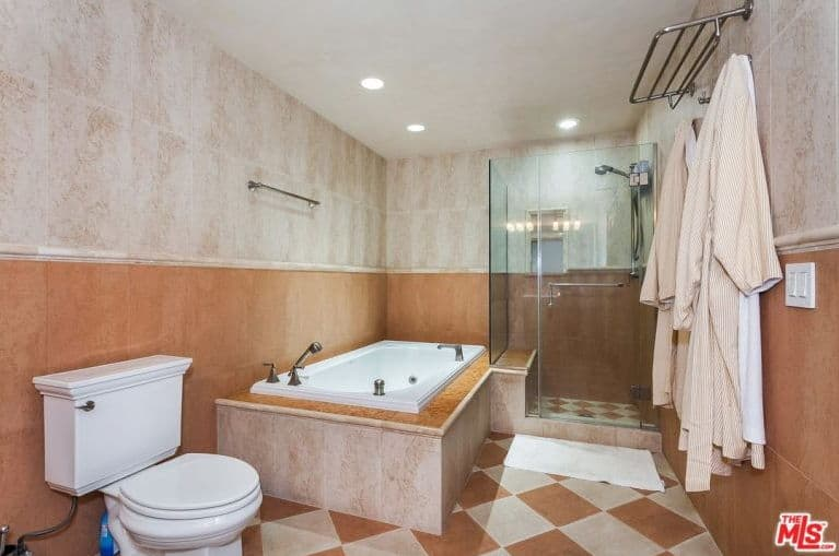 The bathroom looks stylish as well with a perfectly placed bathtub and walk-in shower.