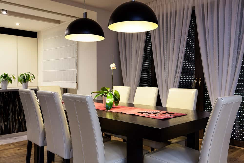 Dining Room With Pendant Lights Above The Dining Table