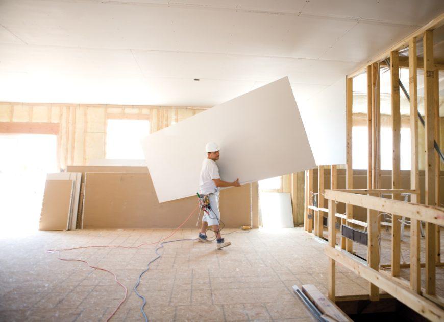 Men drywalling room