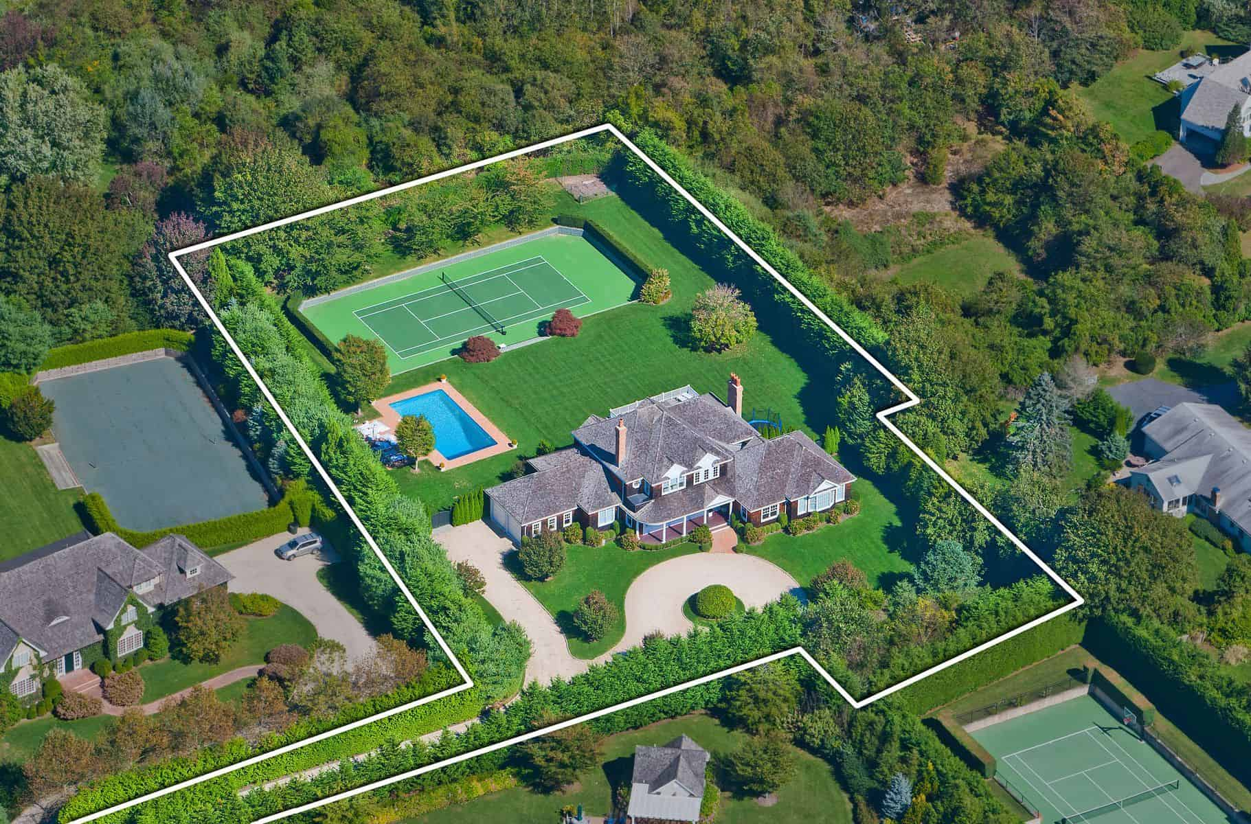 The aerial view of the house showcasing the green and tall trees providing visual protection from neighbors.