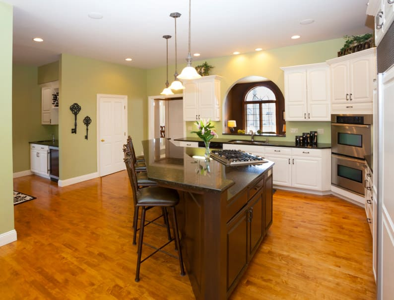 Yellow green, white and medium wood kitchen