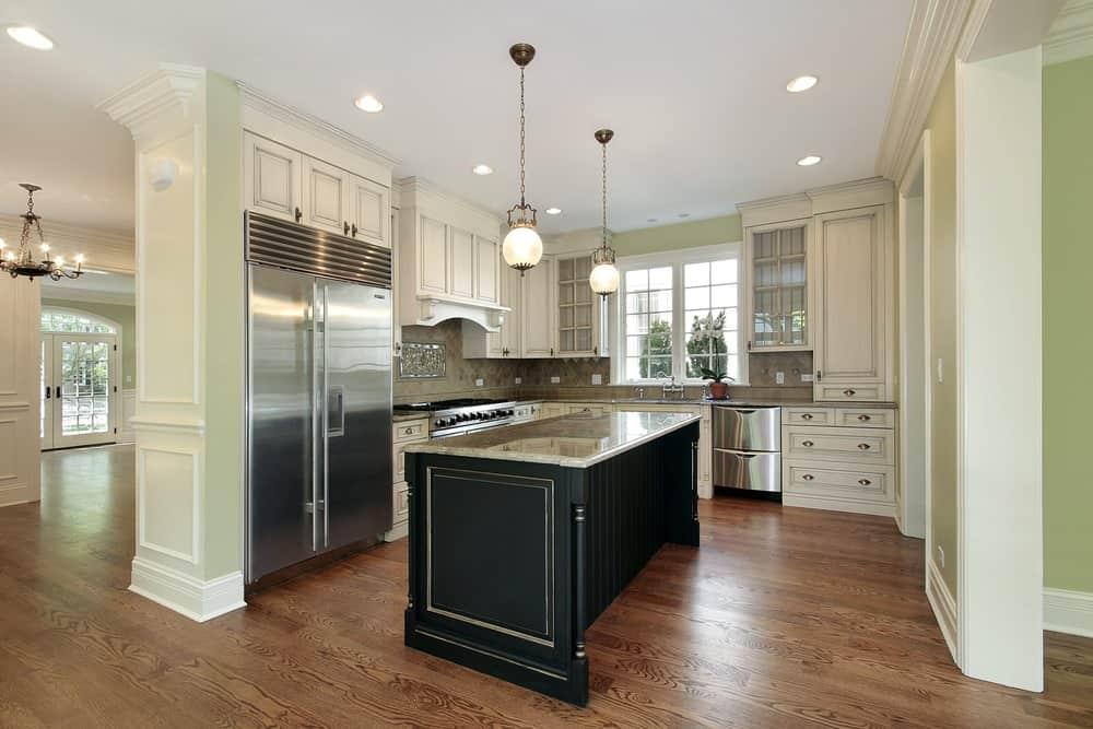 Light green, white and dark wood kitchen
