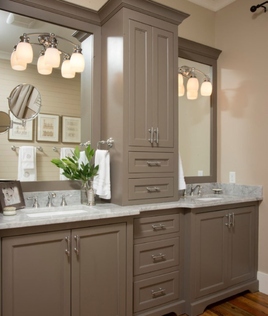 Farmhouse bathroom with two undermount sinks and wall-mounted lights.